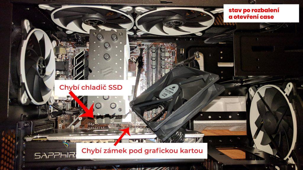 První moment překvapení po otevření PC skříně, již zde jde vidět chybějící zámek pod grafickou kartou.